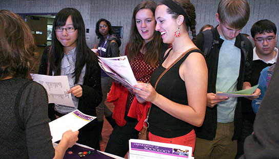 Students at majors fair talking with staff
